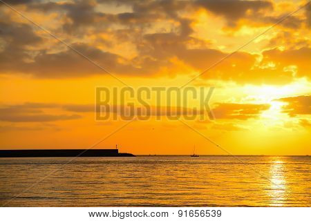 Harbor And Boat Under A Colorful Sunset In Alghero