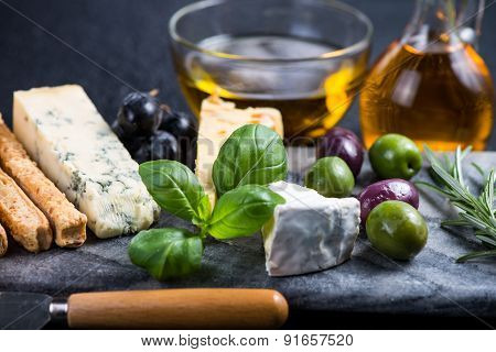 Tapas Style Cheese Selection With Olives,grapes And Herbs