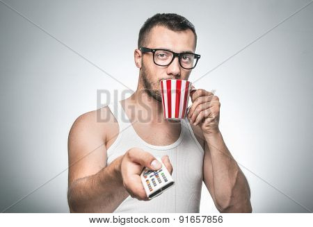 Sleepy Man With Cup Coffee And Control Remote