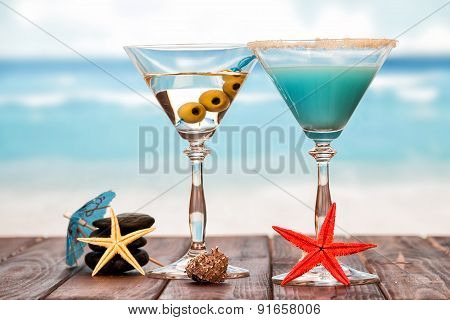 Two cocktails with umbrellas