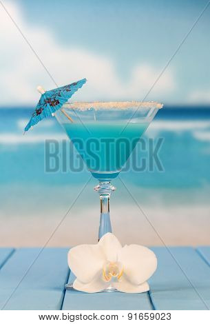 Cocktail with umbrella and flower