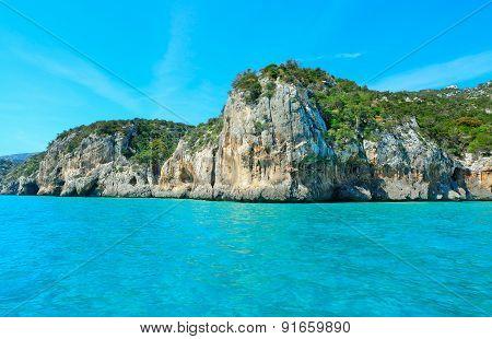 Orosei Gulf Rocky Shore On A Clear Summer Day
