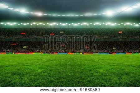 Soccer stadium, arena in night illuminated bright spotlights