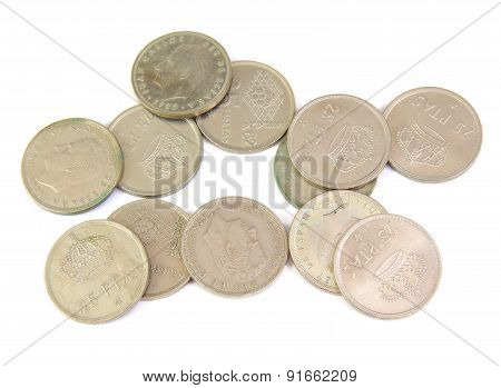Bunch of old Spanish coins isolated on a white background. 25 pesetas.
