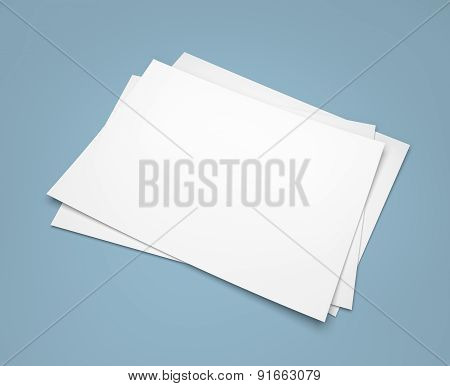 Three White Paper Sheets On Blue