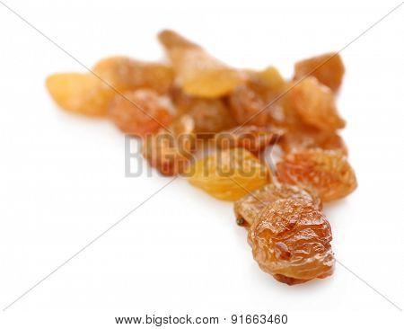Pile of raisins isolated on white
