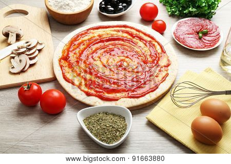 Cooking pizza on wooden table, closeup