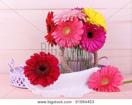 Beautiful bright gerberas in vase on wooden background