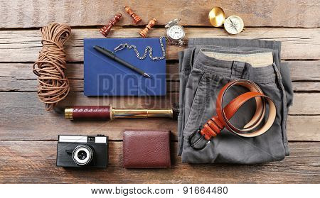 Hiking gear on wooden background