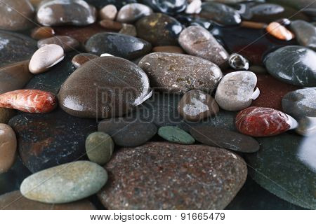 Wet sea pebbles background