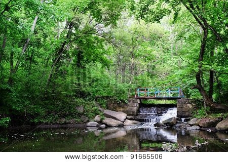 Wooden bridge over river in beautiful park