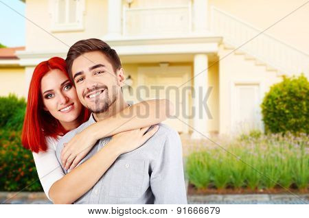 Loving couple near their house
