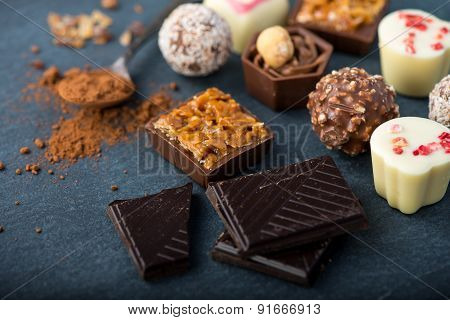 Selection Of Artisan Chocolates Praline On Black Background