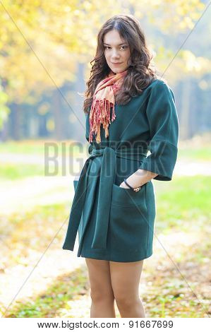 Female Model Standing In Fall Forest Outdoors