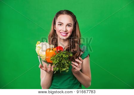 beautiful woman holding a grocery bag full of fresh and healthy food.