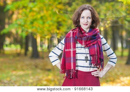 Female Fashion Model Posing In Autumn Forest Outdoors.