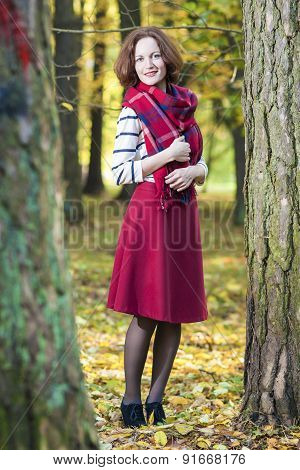 Portrait Of Female Fashion Model Posing In Autumn Forest Outdoors