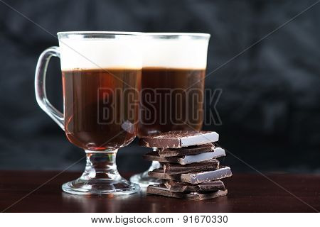Traditional Strong Irish Coffee On Wooden Bar With Dark Chocolate