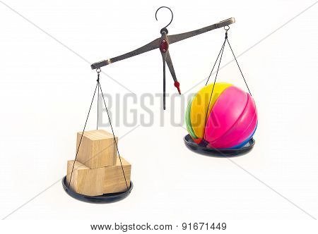 Wooden And Plastic Toys Symbolically Weighed On The Scales.