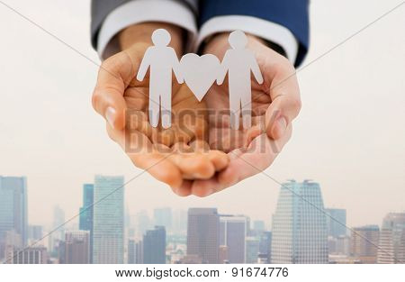 people, homosexuality, same-sex marriage and love concept - close up of male gay couple holding love and gender symbol