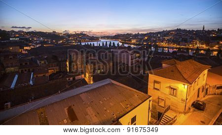 PORTO, PORTUGAL - MAY 15, 2015: View of Old Porto at night time. Porto is called Northern capital of Portugal. In 1996, UNESCO recognised Old Town of Porto as a World Heritage Site.