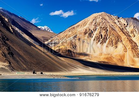 Scenic Beauty Of Mountains And Pangong Tso Lake, Blue Sky And Himalayan Mountains In Background, Leh