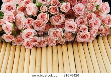 Set of bouquet rose on wooden mat