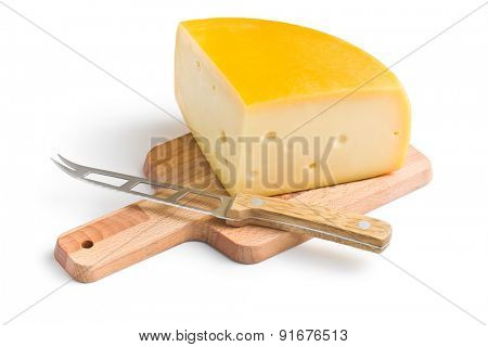 edam cheese and knife on white background