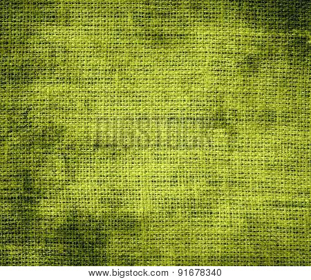 Grunge background of citron burlap texture