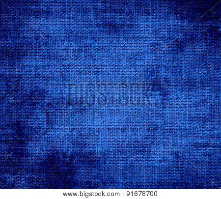 Grunge background of cobalt blue burlap texture