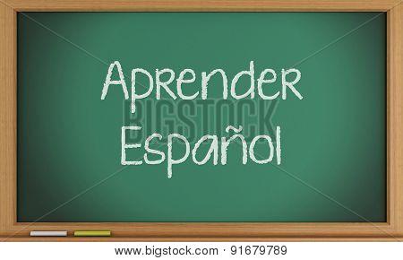 Learn Spanish written on blackboard.