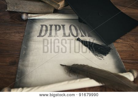 Mortar Board And Diploma, With Text Diplom