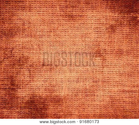 Grunge background of coral burlap texture