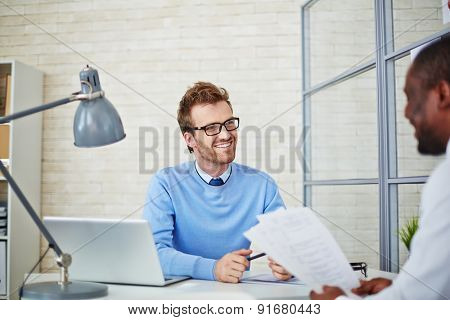 Young manager listening to man hiring for job