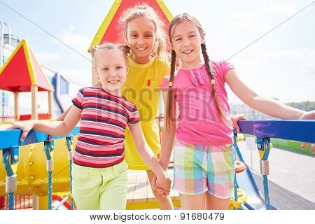 Friendly girls spending leisure on playground
