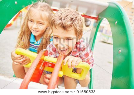 Friendly girl and boy spending leisure on playground