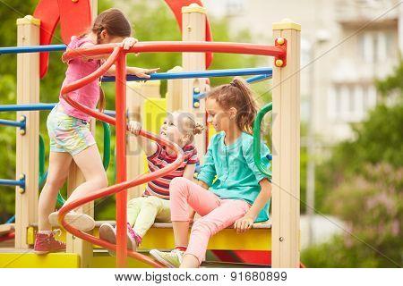 Friendly girls spending weekend on playground