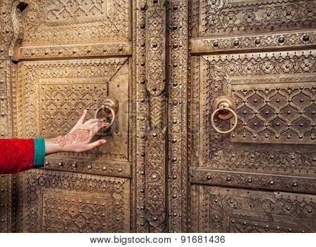 Woman Opening Golden Door In Jaipur