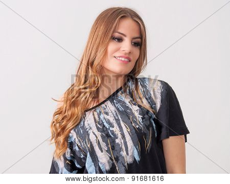 Beautiful teenage girl posing in a black t-shirt