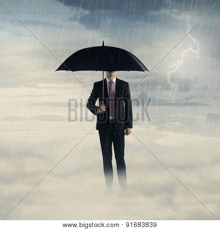 Business Man With Umbrella Standing On The Cloud With Thunder