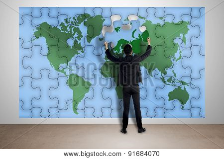 Man Hold Puzzle Of World Map