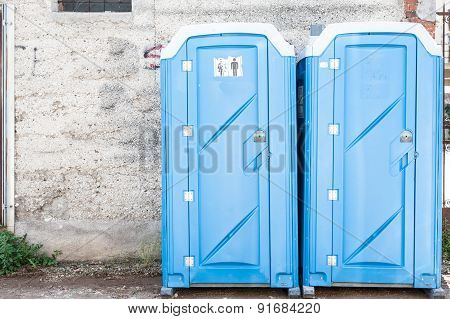 Two Blue Portable Toilet.