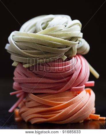 Colorful Pasta Tagliatelle On Black Background