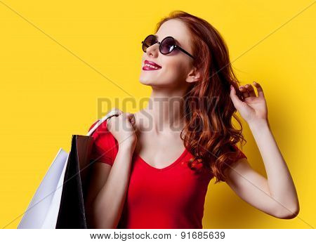 Girl In Red Dress With Shopping Bags