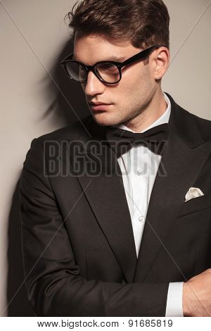 Side view portrait of a young elegant business man wearing glasses.