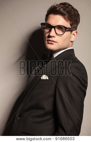 Close up picture of a handsome young elegant business man wearing glasses.