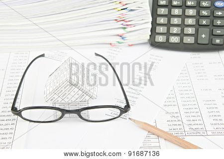Brown Pencil With Spectacles And House On Balance Sheet