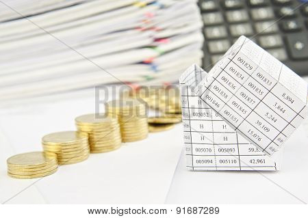 Close Up Bankruptcy Of House And Step Pile Of Coins