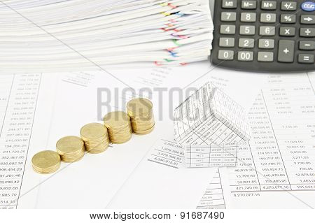 Step Pile Of Gold Coins And House On Balance Sheet