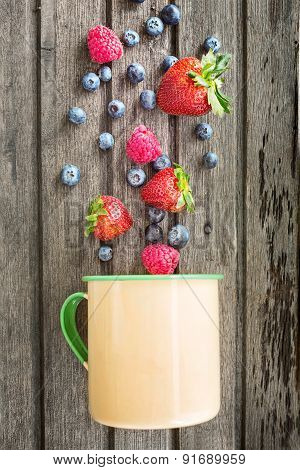 Mix Of Fresh Berries And A Metal Cup, On Wooden Background, Top View